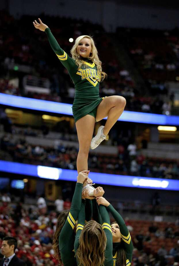 A Baylor cheerleader performs during a regional semifinal NCAA college basketball tournament game against Wisconsin, Thursday, March 27, 2014, in Anaheim, Calif. (AP Photo/Jae C. Hong) Photo: Jae C. Hong, Associated Press / AP