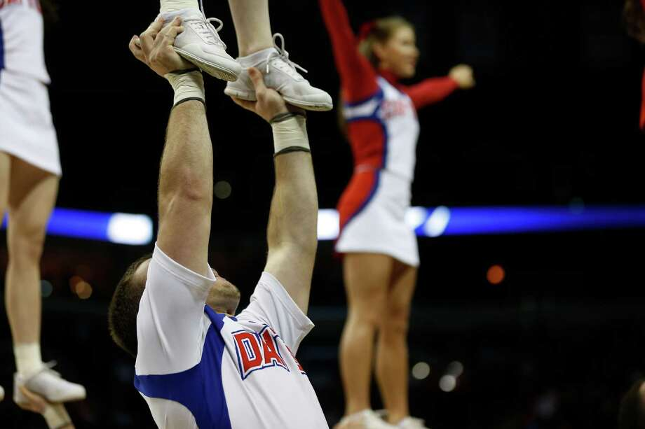Dayton cheerleaders perform during the first half in a regional semifinal game against Stanford at the NCAA college basketball tournament, Thursday, March 27, 2014, in Memphis, Tenn. (AP Photo/John Bazemore) Photo: John Bazemore, Associated Press / AP
