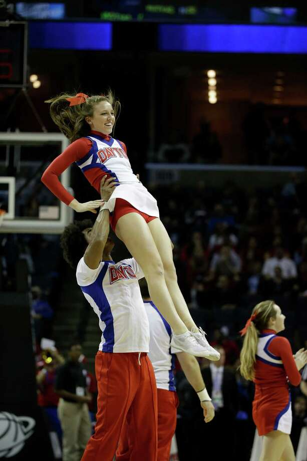 Dayton cheerleaders perform against Stanford during the first half in a regional semifinal game at the NCAA college basketball tournament, Thursday, March 27, 2014, in Memphis, Tenn. (AP Photo/Mark Humphrey) Photo: Mark Humphrey, Associated Press / AP