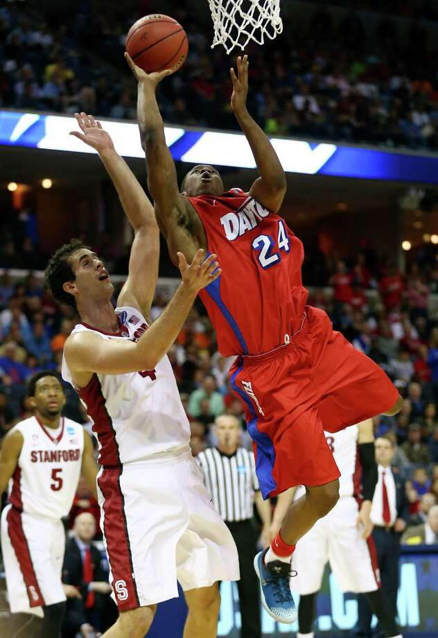 MEMPHIS, TN - MARCH 27: Jordan Sibert #24 of the Dayton Flyers goes to the basket against Stefan Nastic #4 of the Stanford Cardinal during a regional semifinal of the 2014 NCAA Men's Basketball Tournament at the FedExForum on March 27, 2014 in Memphis, Tennessee.  (Photo by Streeter Lecka/Getty Images) ORG XMIT: 459542809 Photo: Streeter Lecka / 2014 Getty Images
