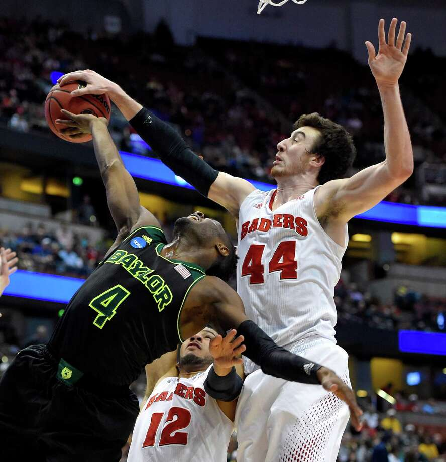 Baylor guard Gary Franklin (4) has a shot stopped by Wisconsin forward Frank Kaminsky (44) during an NCAA men's college basketball tournament regional semifinal, Thursday, March 27, 2014, in Anaheim, Calif. (AP Photo/Mark J. Terrill) ORG XMIT: CACC212 Photo: Mark J. Terrill / AP