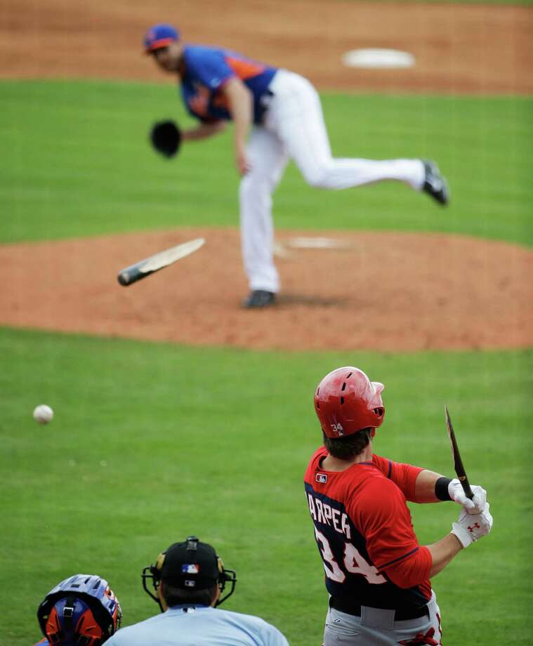 Washington Nationals' Bryce Harper, right, breaks his bat on a ground out off New York Mets pitcher John Lannan, top, in the third inning of an exhibition spring training baseball game, Thursday, March 27, 2014, in Port St. Lucie, Fla. (AP Photo/David Goldman) ORG XMIT: FLDG110 Photo: David Goldman / AP