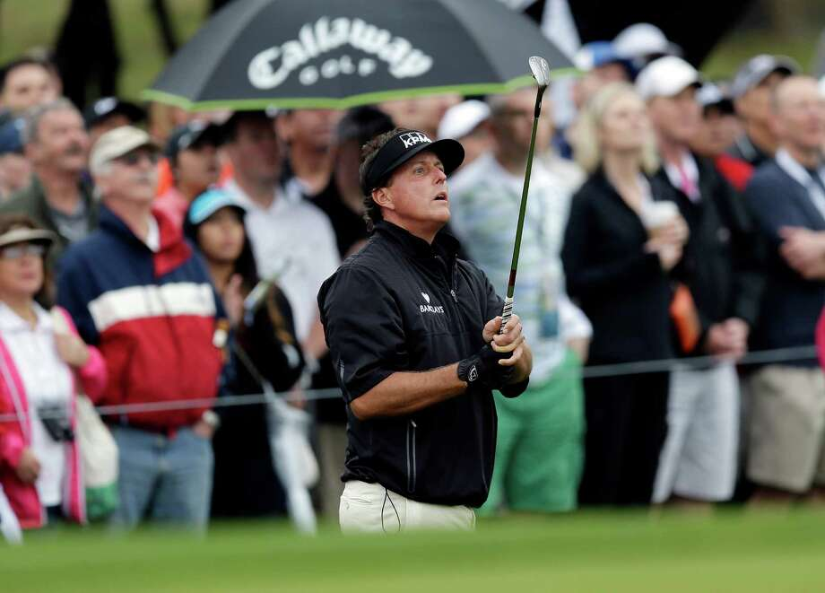 A chip shot on the 10th hole was only the beginning of Phil Mickelson's opening-round misadventures en route to a 5-over 77 on Thursday in the Texas Open. Photo: Eric Gay, STF / AP