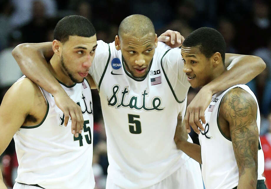 Denzel Valentine (45), Adreian Payne (5) and Keith Appling have their sights set on beating Virginia on Friday and then playing for a Final Four spot Sunday. Photo: Stephen Dunn, Staff / 2014 Getty Images