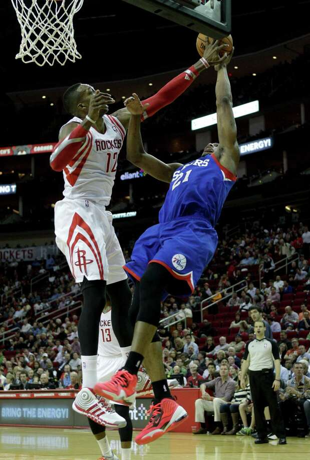 Philadelphia 76ers' Thaddeus Young (21) has his shot blocked by Houston Rockets' Dwight Howard (12) during the first half of an NBA basketball game on Thursday, March 27, 2014, in Houston. (AP Photo/Bob Levey) ORG XMIT: TXBL107 Photo: Bob Levey / FR156786 AP
