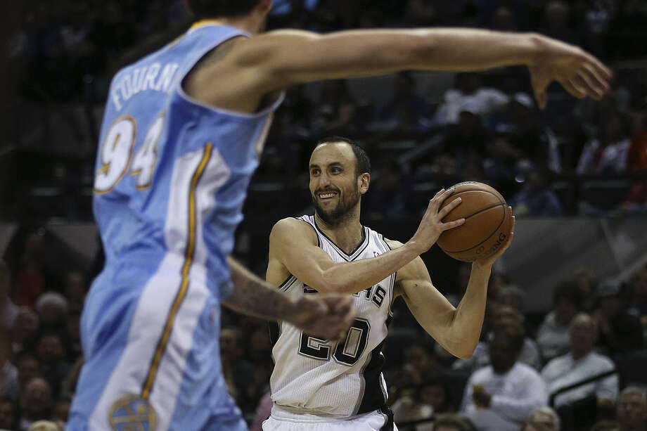 Veteran guard Manu Ginobili (right) and his fellow Spurs will try to extend their NBA-best winning streak to 16 games on Friday night in Denver. Photo: Jerry Lara / San Antonio Express-News / ©2013 San Antonio Express-News