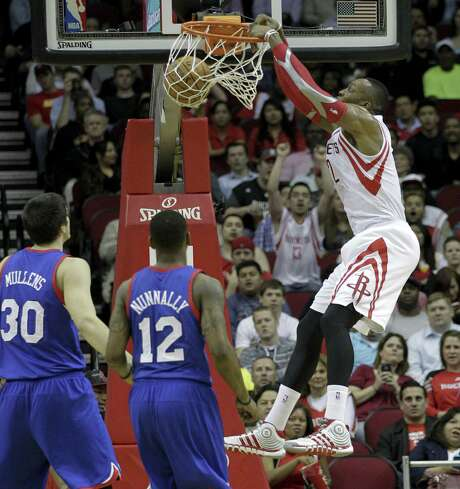 Houston's Dwight Howard had a double-double (17 points, 13 rebounds) along with three blocks as the Rockets handed Philadelphia its 26th straight loss. Photo: Bob Levey / Associated Press / FR156786 AP