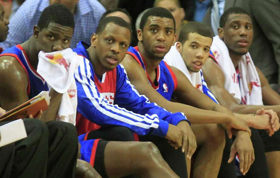 Blank looks are about as good as its gets on the 76ers' bench these days. With Thursday night's 120-98 loss to the Rockets at Toyota Center, Philadelphia tied the NBA record for consecutive defeats at 26. Photo: Johnny Hanson, Staff / © 2014  Houston Chronicle