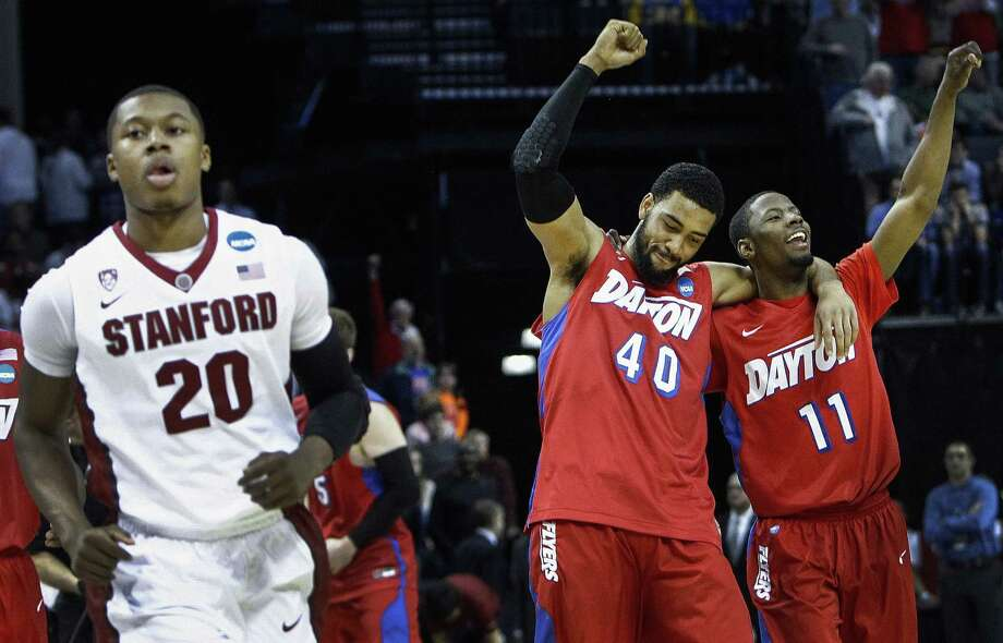 Stanford's Wade Morgan, left, reaches the end of the line while Dayton's Devon Scott (40) and Scoochie Smith waltz into the Elite Eight. Photo: Mark Weber, MBR / The Commercial Appeal