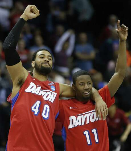 Dayton's Devon Scott (left) and Scoochie Smith rejoice after their 82-72 South Regional semifinal victory over Stanford. Photo: John Bazemore / Associated Press / AP