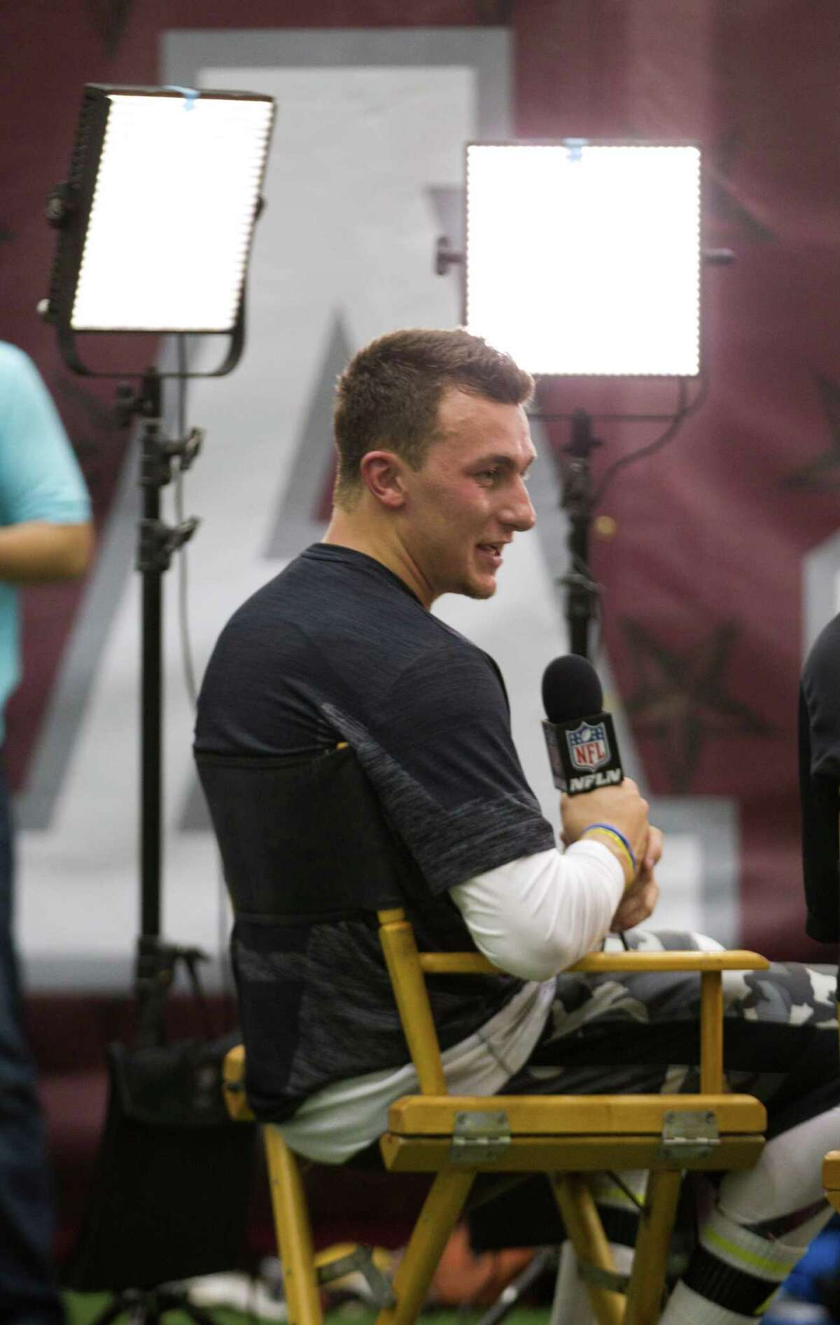 Former Texas A&M quarterback Johnny Manziel gives an interview to the NFL Network following his pro day at McFerren Athletic Center Thursday, March 27, 2014, in College Station. Several NFL coaches and scouts attended the event, including Houston Texans head coach Bill O'Brien and general manger Rick Smith. ( Brett Coomer / Houston Chronicle )