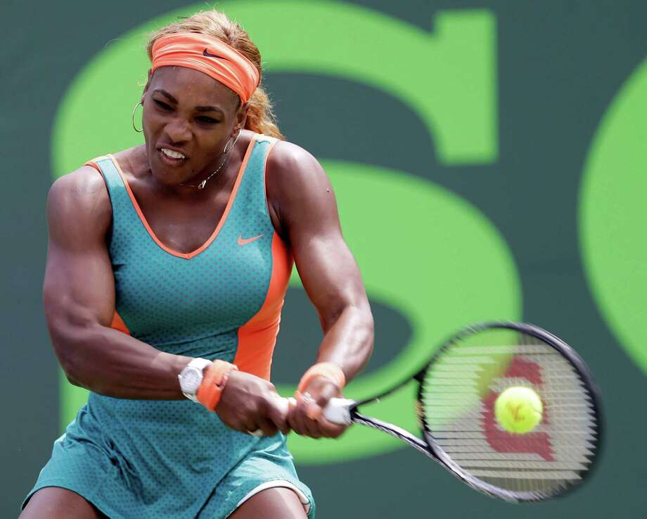 Serena Williams muscles a return in Maria Sharapova's direction in the Sony Open semifinals Thursday. Williams beat her rival for the 15th consecutive time. Photo: Alan Diaz, STF / AP