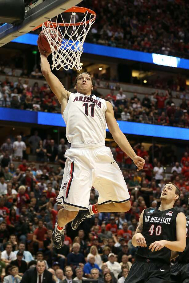 Arizona's Aaron Gordon soars for a second-half dunk in the Wildcats' win over San Diego State. Photo: Jeff Gross, Getty Images