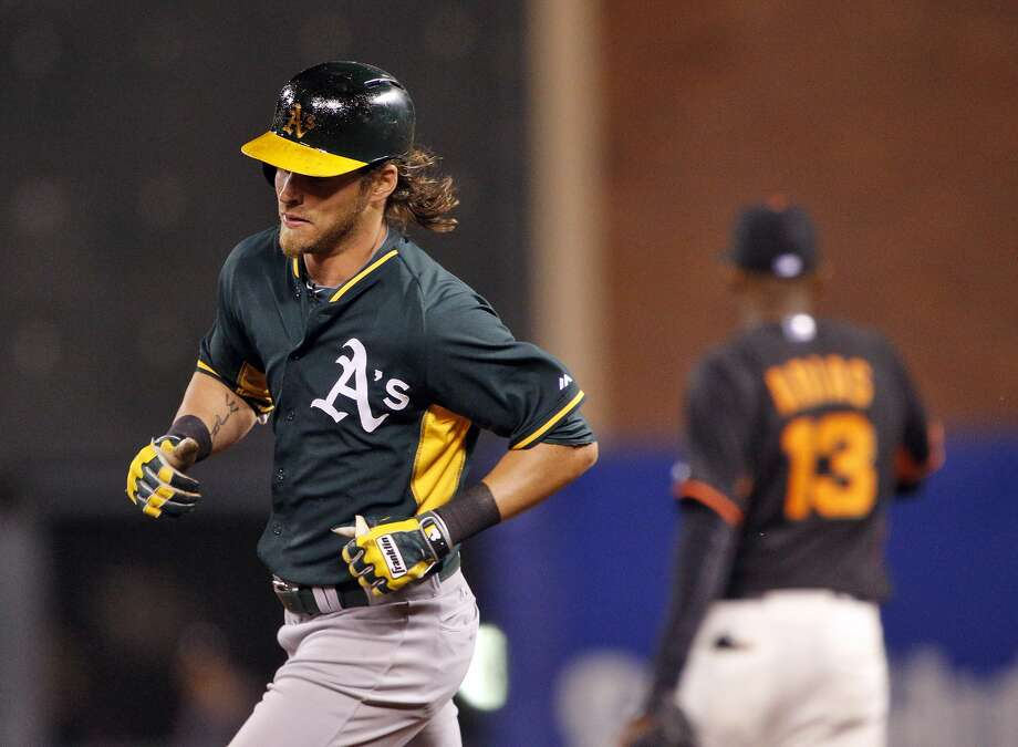 Josh Reddick rounds the bases after hitting a two-run homerun in the sixth inning. The San Francisco Giants played the Oakland Athletics in a pre-season game at AT&T Park in San Francisco, Calif., on Thursday, March 27, 2014. Photo: Carlos Avila Gonzalez, The Chronicle