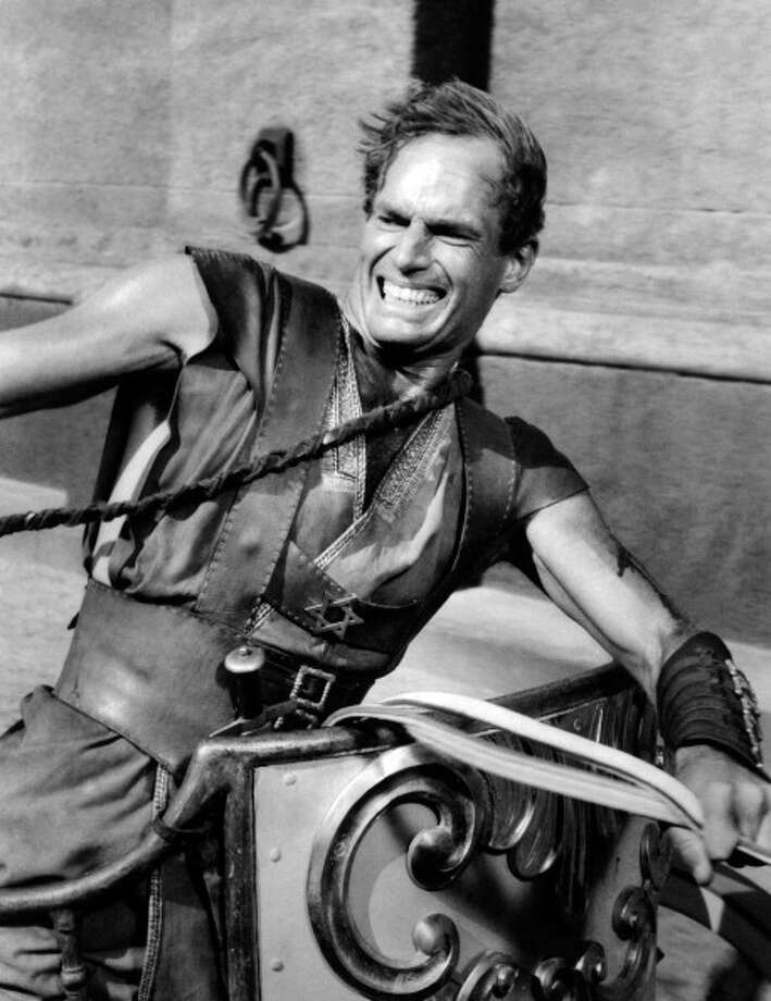 Charlton Heston (Ben Hur) fighting Messala, not in the frame, who is lashing out with a whip, during the renowned scene of the bigae race from the movie Ben-Hur. Rome, Italy, 1959.  Photo: Mondadori, Mondadori Via Getty Images / Mondadori