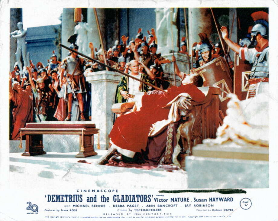 People celebrate as the emperor is stabbed in a scene from the film 'Demetrius And The Gladiators', 1954.  Photo: Archive Photos, Getty Images / 2012 Getty Images