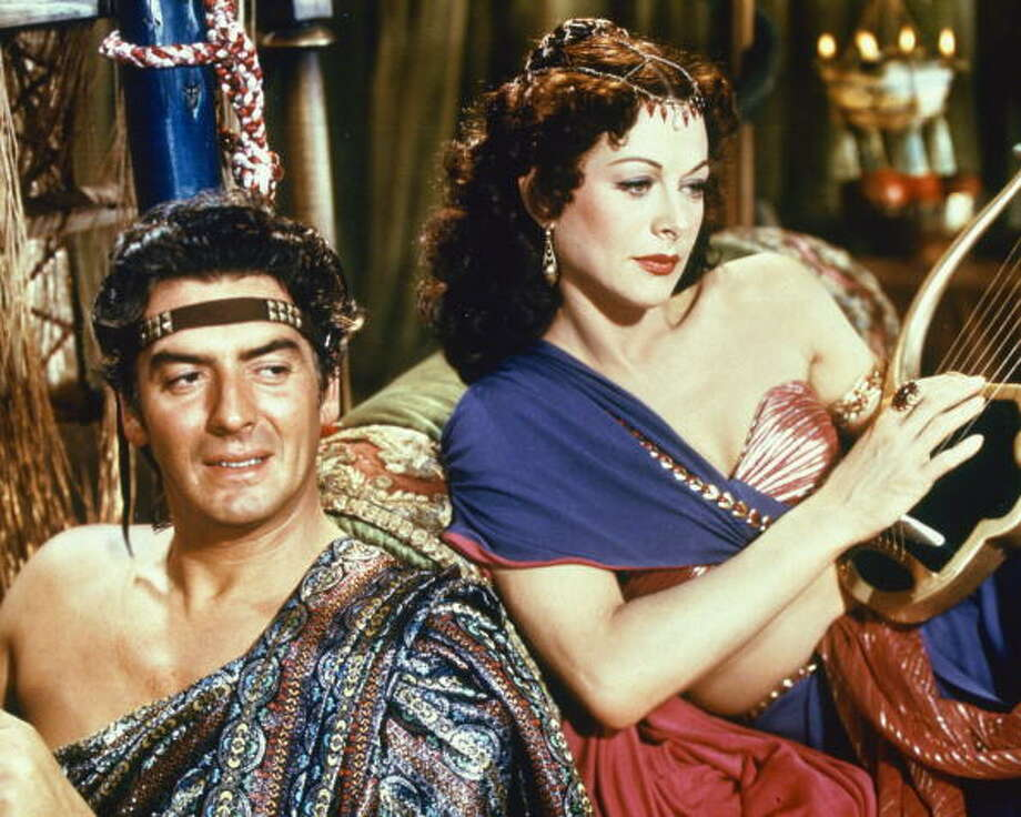 Austrian-born actress Hedy Lamarr as Delilah and American actor Victor Mature (1915 - 1999) as Samson in Cecil B. DeMille's film 'Samson and Delilah', 1949.  (Photo by Silver Screen Collection/Hulton Archive/Getty Images) Photo: Silver Screen Collection, Getty Images / 2006 Getty Images