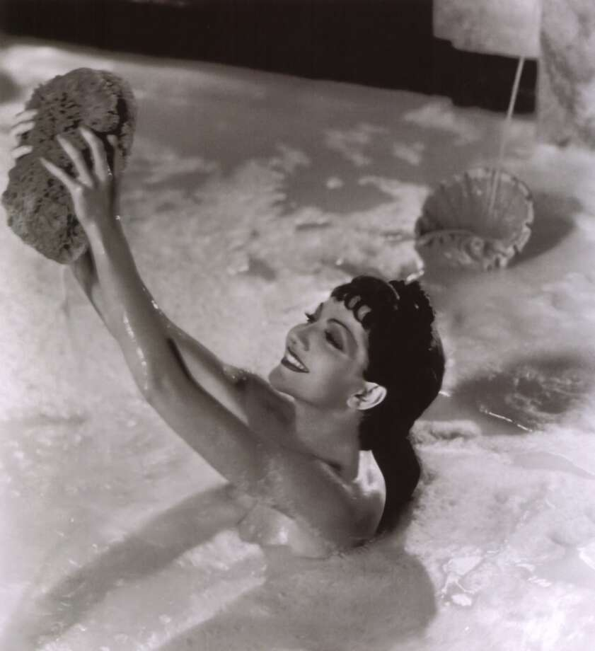 SIGN OF THE CROSS -- Claudette Colbert's nude milk bath in DeMille's 1932 film.