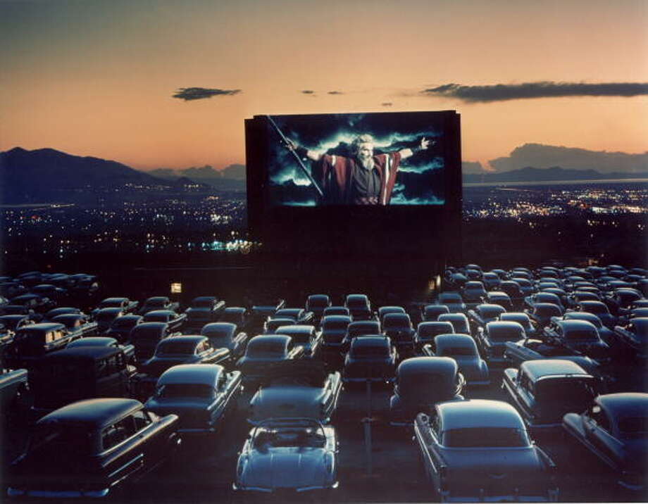 "Actor Charlton Heston as Moses with arms flung wide appearing in motion picture ""The Ten Commandments"" as it is shown at drive-in movie theater.  (Photo by J. R. Eyerman/Life Magazine/Time & Life Pictures/Getty Images) Photo: J. R. Eyerman, Time & Life Pictures/Getty Image / Time & Life Pictures"