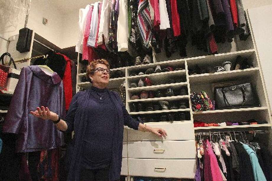 Whitney Bischoff shows off her pared-down closet. Photo: Tom Reel, San Antonio Express-News