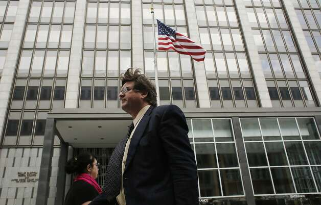 Walking past the Federal building, Paul DeMeester, attorney for California state senator Leland Yee, prepares to announce that his client will drop his race for Secretary of State on Thursday March 27, 2014 in San Francisco, Calif. Photo: Mike Kepka, The Chronicle