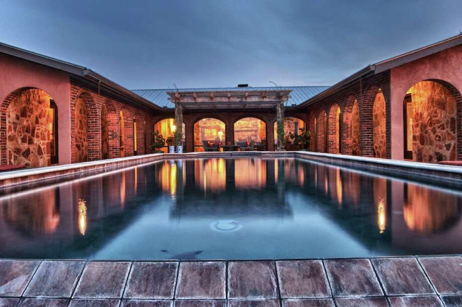 Rustic-chic Tres Lunas Resort in the Texas Hill Country has a vanishing edge pool. / Steve Bushman