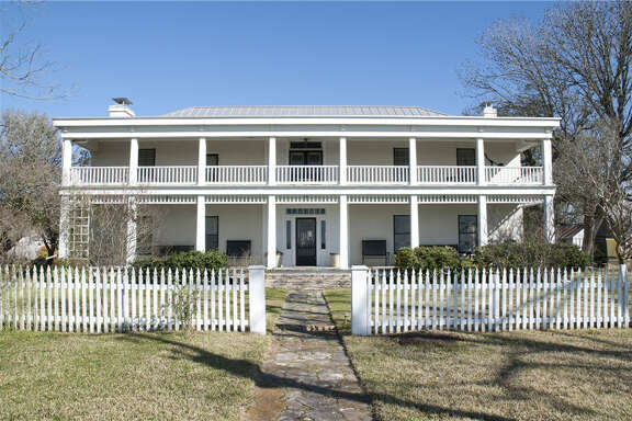 The circa 1840-1845 Gindorf House near Brenham is an imposing sight from all directions. Barbara and Richard Powell bought it in 1981 and spent a decade renovating it.