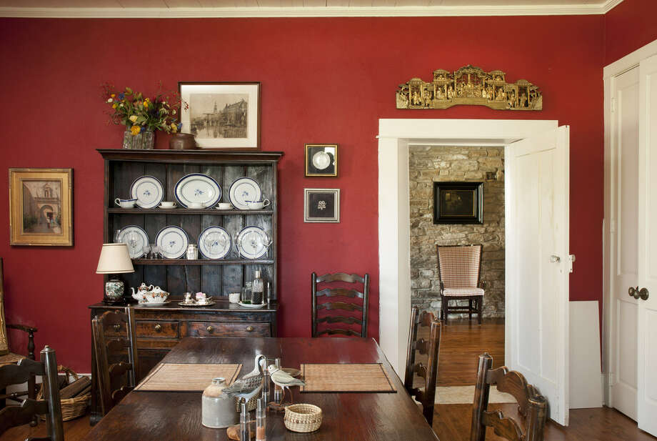 The Powells have created a gracious, antique-filled dining room in the oldest room of the house. They re-plastered its walls because the earlier stone walls there were crude and uneven, unlike the magnificent work in other rooms. Photo: Don Glentzer / ONLINE_YES