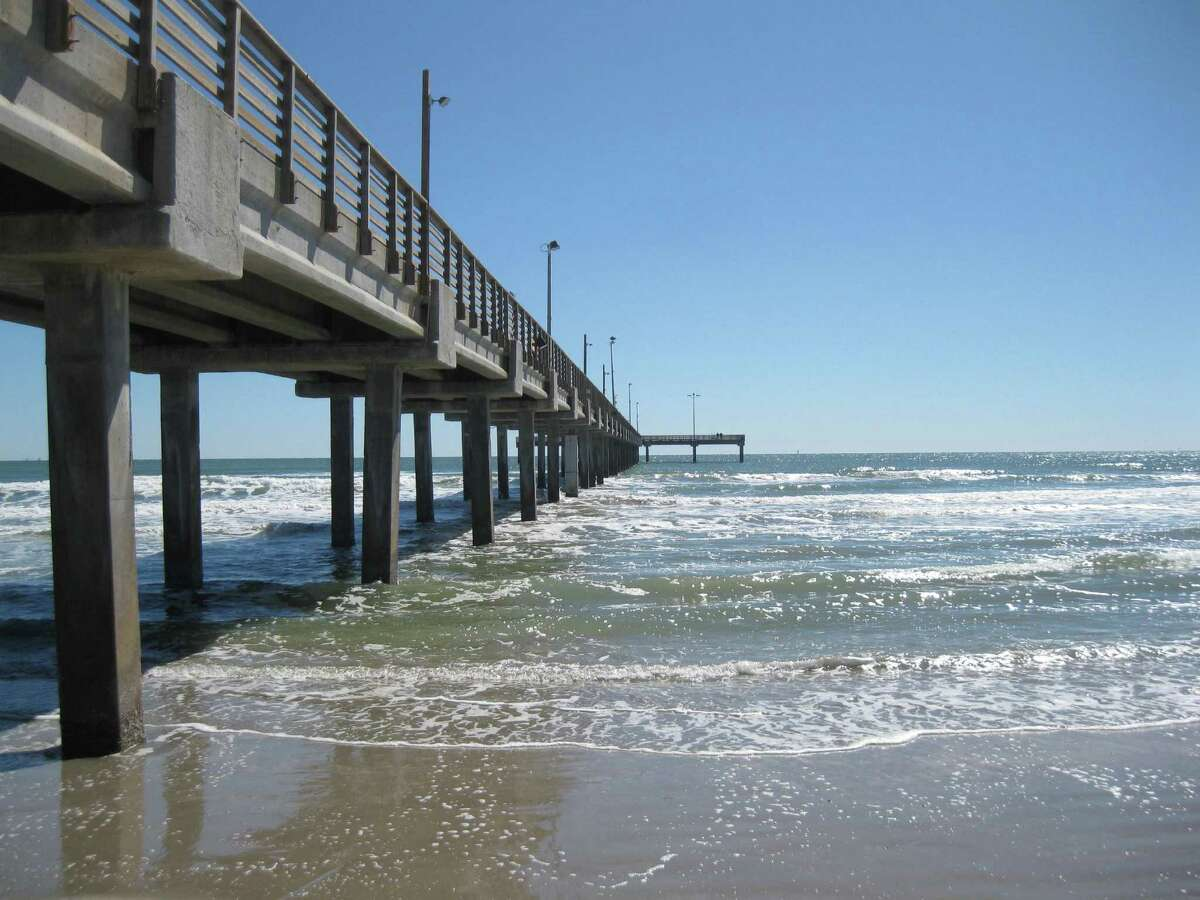 Caldwell Pier is a featured attraction on the Port Aransas beach, offering fishing or just a chance to walk a few 100 meters out into the open water for a small fee.