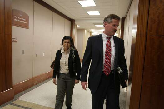 Ana Lilia Trujillo, 45, arrives for court Friday, March 28, 2014, with her attorney, Jack Carroll, for jury selection in her murder trial. Photo: James Nielsen, Houston Chronicle