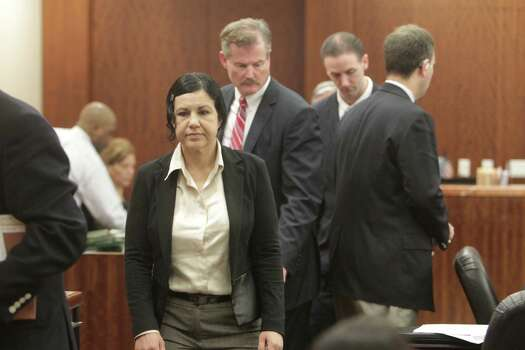 Ana Lilia Trujillo, 45, appears in court Friday, March 28, 2014, with her attorney, Jack Carroll, for jury selection in her murder trial. Photo: James Nielsen, James Nielsen/Houston Chronicle / Houston Chronicle 2011