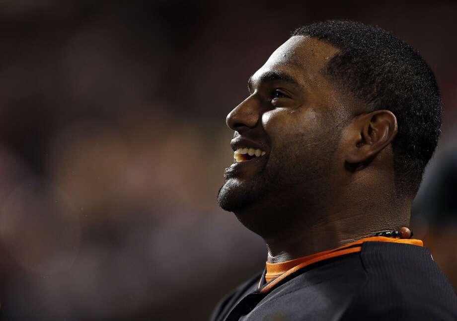Pablo Sandoval smiles in the dugout after almost hitting a two-run homerun in the sixth inning. The San Francisco Giants played the Oakland Athletics in a pre-season game at AT&T Park in San Francisco, Calif., on Thursday, March 27, 2014. Photo: Carlos Avila Gonzalez, The Chronicle
