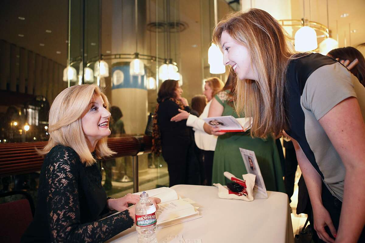 Arianna Huffington, left, signs a book for Myla Tutt of San Francisco following her interviewed by Sheryl Sandberg during a Commonwealth Club held forum entitled Redefining Success, at Davies Symphony Hall in San Francisco, CA, Thursday March 27, 2014.