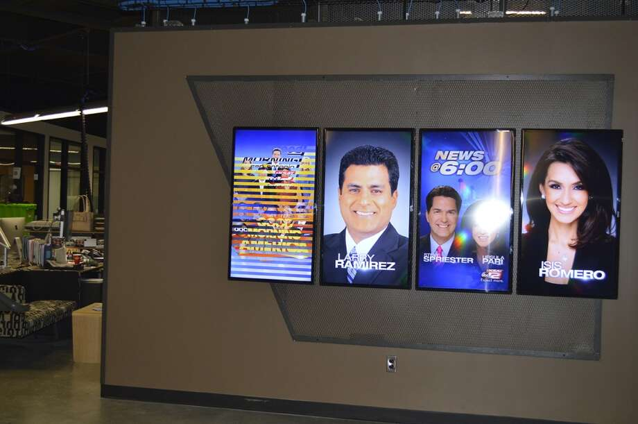Anchor Wall: Images of sportscaster  Larry Ramirez,anchorwoman Isis Romero and others grace the entryway into the newsroom from the main lobby. Photo: KSAT