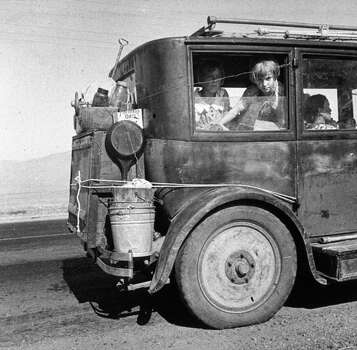 A family of drought refugees from Abilene, Texas, on the road in California, where they are trying to find work.   (Photo by Dorothea Lange/Getty Images) Photo: Dorothea Lange, Getty Images / Hulton Archive