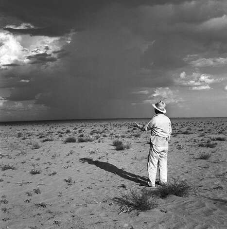 A farmer putting out his hand in the hope that a distant rainstorm will bring relief to his land, which is suffering from a drought, Texas, June 1953. (Photo by John Dominis/Time & Life Pictures/Getty Images) Photo: John Dominis, Time Life Pictures/Getty Images / Time & Life Pictures