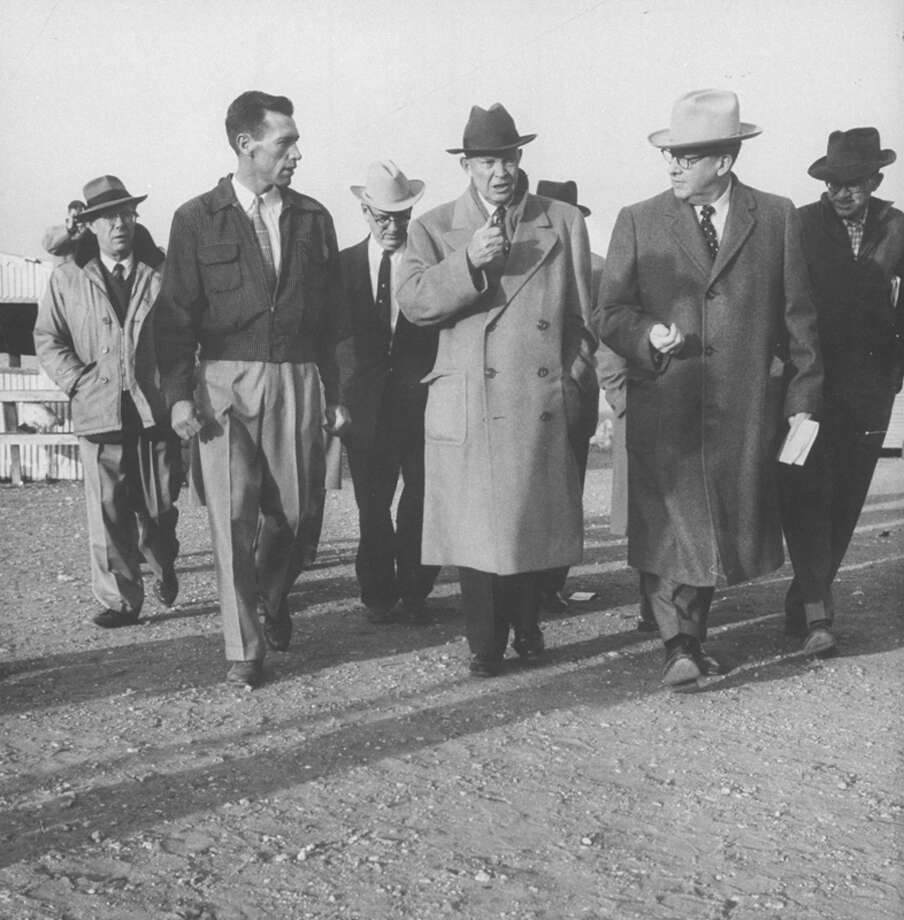 Ezra T. Benson (2R) walking with Pres. Dwight D. Eisenhower (C) during tour of the southwest.  (Photo by Paul Schutzer//Time Life Pictures/Getty Images) Photo: Paul Schutzer, Time & Life Pictures/Getty Image / Time Life Pictures