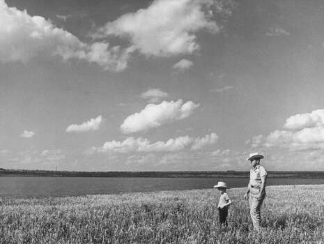 Farmer with son in field during drought.  (Photo by Joseph Scherschel//Time Life Pictures/Getty Images) Photo: Joseph Scherschel, Time & Life Pictures/Getty Image