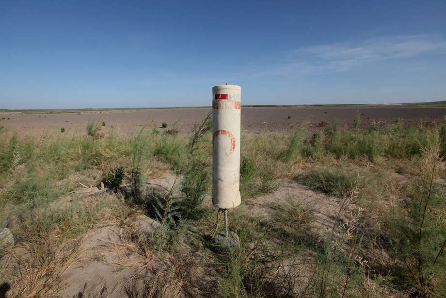 A buoy, which alerts boater of a no-wake zone, rests on the dry bed of O.C. Fisher Lake on July 25, 2011 in San Angelo, Texas. The 5,440 acre lake which was established to provide flood control and serve as a secondary drinking water source for San Angelo and the surrounding communities is now dry following an extended drought in the region. The lake which has a maximum depth of 58 feet is also used for boating, fishing and swimming. The San Angelo area has seen only 2.5 inches of rain this year. The past nine months have been the driest in Texas since record keeping began in 1895, with 75% of the state classified as exceptional drought, the worst level.  (Photo by Scott Olson/Getty Images) Photo: Scott Olson, Getty Images