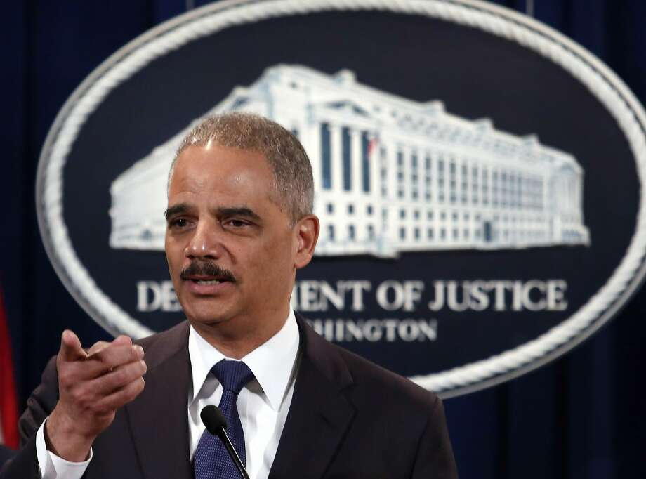 U.S. Attorney General Eric Holder speaks at a news conference at the Justice Department  in Washington in this March 19, 2014 file photo. The federal government will recognize same-sex marriages in Michigan while an appeal is pending in court, U.S. Attorney General Eric Holder said on March 28, 2014, guaranteeing the families relevant federal benefits.   REUTERS/Yuri Gripas/Files (UNITED STATES - Tags: POLITICS SOCIETY) Photo: Yuri Gripas, Reuters
