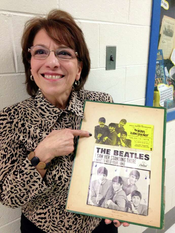 Linda Mitten shows part of her Beatles memoribilia collection. Photo: Contributed Photo / The News-Times Contributed