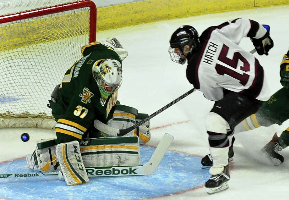 Union College's Matt Hatch gets the puck past Vermont goalie Brody Hoffman to score, during the 2014 NCAA Men's Ice Hockey East Regional at the Webster Bank Arena in Bridgeport, Conn. on Friay March 28, 2014. Photo: Christian Abraham / Connecticut Post