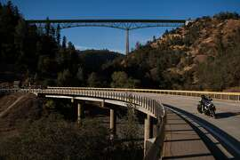 The Foresthill Bridge, the tallest bridge in California and the site of suicides, looms over the confluence of the North and Middle forks of the American River, October 11, 2013 in Auburn, California.