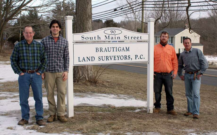 Paul  Brautigam, left, a licensed land surveyor and owner and founder of Brantigam Land Surveyors, and his crew,  from left, Max Beitel, Steve Murtha and PaulâÄôs brother, Joe Brautigam, also a licensed land surveyor, are celebrating the firmâÄôs 25th anniversary in 2014. Contributed photo. Photo: Contributed Photo / The News-Times Contributed