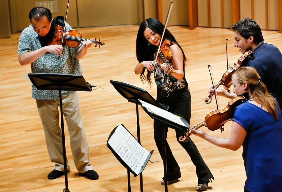 Cho-Liang Lin (left), Chee-Yun, Philippe Quint and Margaret Batjer play Stradivarius violins Thursday during Strad Fest LA. Photo: Damian Dovarganes, Associated Press