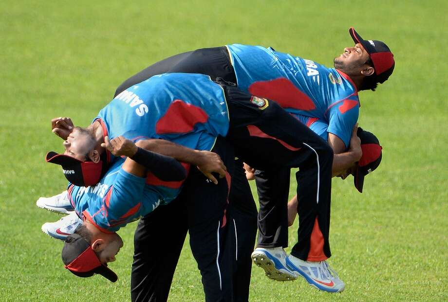 I got your back: Bangladesh cricket players stretch before practice at the Sher-e-Bangla 