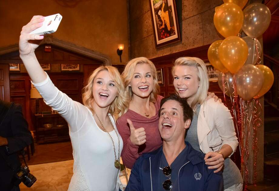 Soapy selfie:Hunter King (left), Jessica Collins, Christian Le Blanc and Kelli Goss pose 
