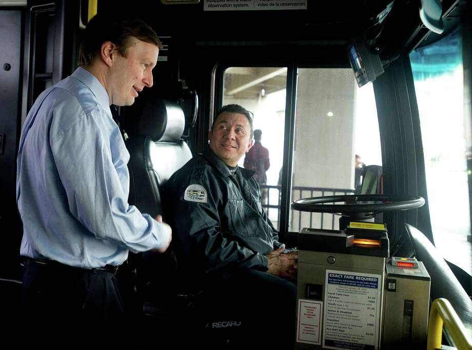 Sen. Chris Murphy speaks with bus driver Hector Jacinto before he rode the Stamford bus from the transit center up the Hope Street line on Friday, March 28, 2014. Photo: Lindsay Perry / Stamford Advocate