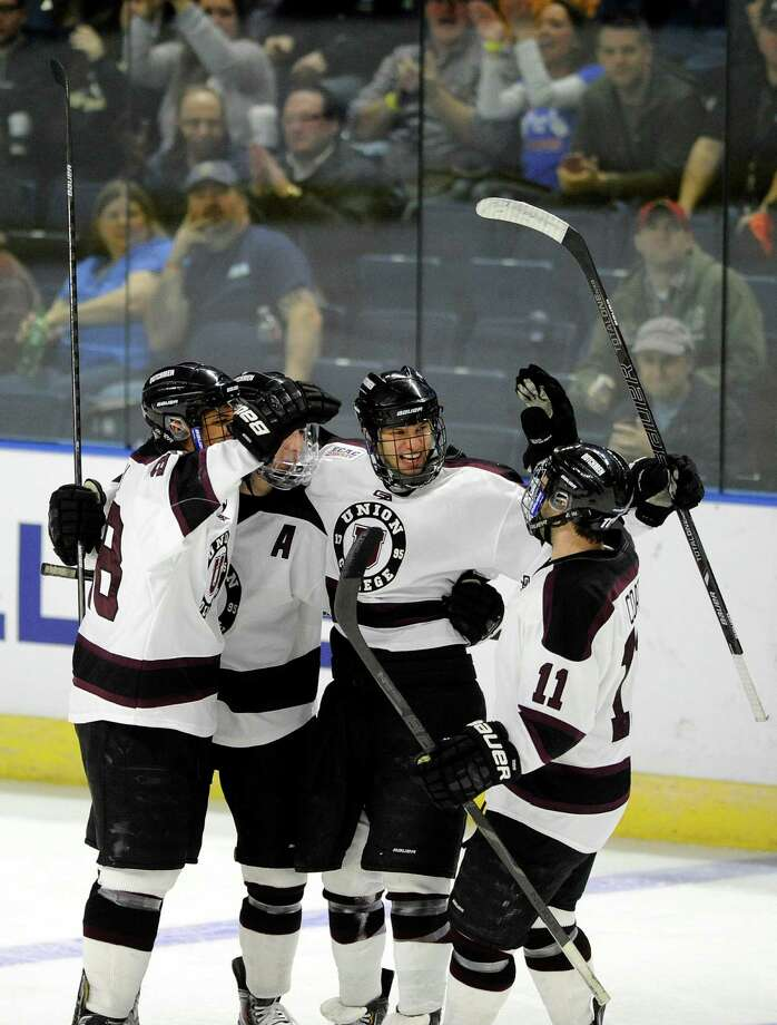 Union players celebrate their first goal against Vermont during the first period of a game in the men's NCAA East Regional hockey tournament Friday, March 28, 2014, in Bridgeport, Conn. (AP Photo/Fred Beckham) Photo: Fred Beckham / FR153656 AP