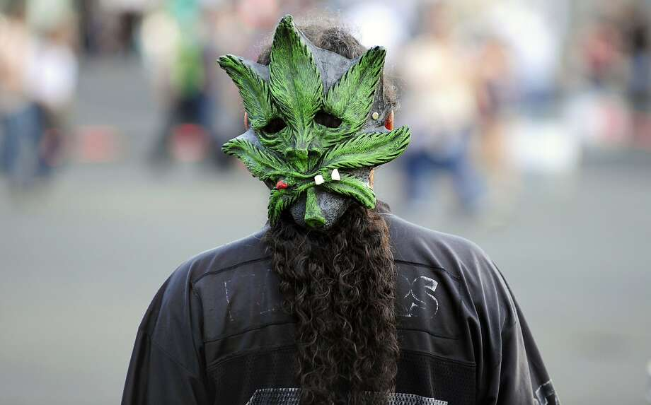One toke over the line: A pothead attends the Vive Latino music festival at the Foro Sol in Mexico City. Photo: Alfredo Estrella, AFP/Getty Images